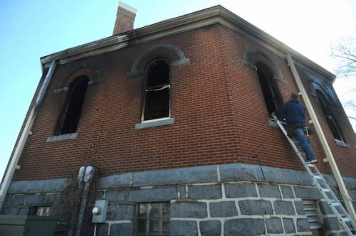 Dave Olsen from ServiceMaster evaluates the damage to St. Mary Church March 12. Photo by Dianne Towalski / The Visitor