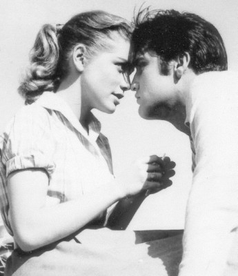 "Dolores Hart and Elvis Presley star in the 1957 movie ""Loving You."" CNS photo/courtesy of Ignatius Press"