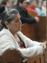 Alicia Martinez prays before Mass. Photo by Dianne Towalski / The Visitor