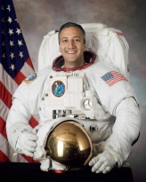 Retired astronaut Mike Massimino, who is Catholic, said that seeing Earth's beauty from orbit confirmed God's love for all people. He is pictured in an undated photo. (CNS photo/courtesy NASA)