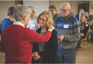 Karen Van Slyke, a member of Christ Church Newman Center in St. Cloud, smiles while being blessed by Franciscan Sister Carolyn Law, during the Social Ministry conference April 10 hosted by the Franciscan Sisters of Little Falls. Photo by Paul Middlestaedt / For The Visitor