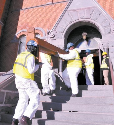 Crews from ServiceMaster remove pews from St. Mary Church in Melrose March 24. Photo courtesy of the Melrose Beacon.