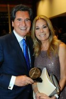 Ernie Anastos, winner of the Christopher Lifetime Achievement Award, poses with presenter Kathy Lee Gifford during the May 19 ceremony in New York. The award recognizes individuals whose personal and professional contributions to making the world a better place have left an indelible mark on our culture. (CNS photo/Paul Schneck, The Christophers)
