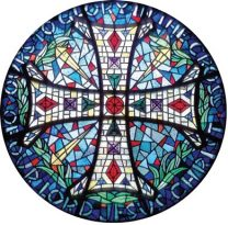 """The rose window features the Crosier cross surrounded by their motto, """"Ours to Glory in the Cross of our Lord Jesus Christ."""""""