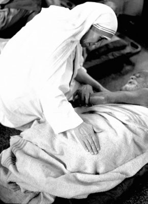 Mother Teresa is pictured with an ailing man in this undated photo. (CNS photo courtesy Catholic Press Photo)