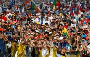 The crowd reacts as Pope Francis arrives to celebrate the closing Mass of World Youth Day at Campus Misericordiae in Krakow, Poland, July 31. (CNS photo/Paul Haring)