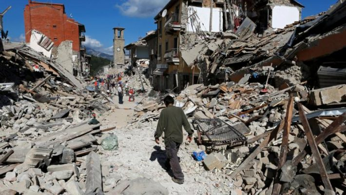 A man walks amid rubble following an earthquake in Amatrice, Italy, Aug. 24. (CNS photo/Remo Casilli, Reuters)