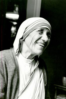 Blessed Teresa of Kolkata smiles during the opening of a Missionaries of Charity convent in Detroit in 1979. (CNS photo)