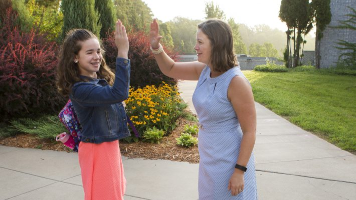 "Sixth grader Ashlee Delre gets a ""high five"" from new St. John's Preparatory School principal XXXXXX Wednesday in Collegeville.  Photo by Paul Middlestaedt"