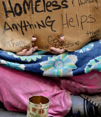 A homeless woman sits on a sidewalk in 2014 in New York City. Despite there being 46.7 million Americans living in poverty, there has been little talk about the needs of poor people on the presidential campaign trail. (CNS photo/Justin lane, EPA)