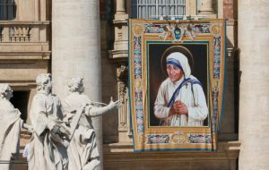 A tapestry of St. Teresa of Kolkata is seen on the facade of St. Peter's Basilica as Pope Francis celebrates her canonization Mass. (CNS photo/Paul Haring) See MOTHER-TERESA-SAINT Sept. 4, 2016.