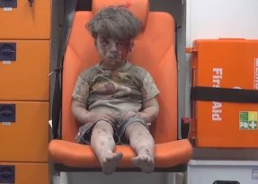 Five-year-old Omran Daqneesh sits inside an ambulance after he was rescued following an airstrike in the rebel-held al-Qaterji neighborhood of Aleppo, Syria, Aug. 17. (CNS photo/Aleppo Media Center via EPA)