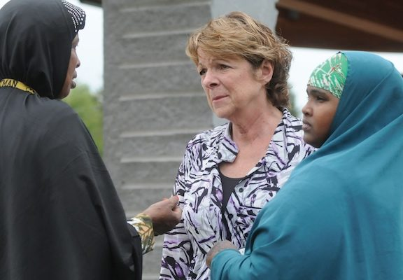 Kathy Langer, director of social concerns for Catholic Charities of the Diocese of St. Cloud, center, talks with Maryan Ahmed and Fatumo Ukash following a Sept. 18 news conference organized by the local Somali-American community in St. Cloud after a knife-wielding man injured 10 people the previous day at Crossroads Center mall in St. Cloud. (Dianne Towalski/The Visitor)