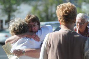 Joann Keller hugs her best friend Scottie Jerzak after the service. (Dianne Towalski/The Visitor)
