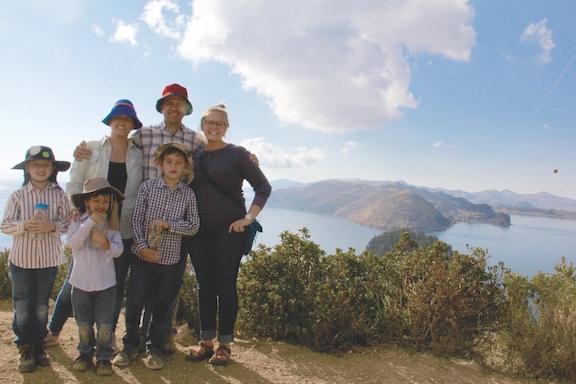 Molly Minnerath, right, poses with her host family in Isla del Sol, Bolivia.(Photo courtesy of Molly Minnerath)