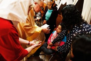 Los Angeles Archbishop Jose H. Gomez prays over a child during the Anointing of the Sick at the Cathedral of Our Lady of the Angels in Los Angeles. (CNS photo/Victor Aleman, Vida-Vueva.com)