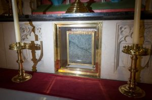 An encasement of a hair shirt worn by St. Thomas More as he contemplated a martyr's death in the Tower of London, before his 1535 beheading, is on display at the altar of England's Buckfast Abbey Nov. 18 photo. (CNS photo/Luke Michael Davies, courtesy Buckfast Abbey Media Studios)