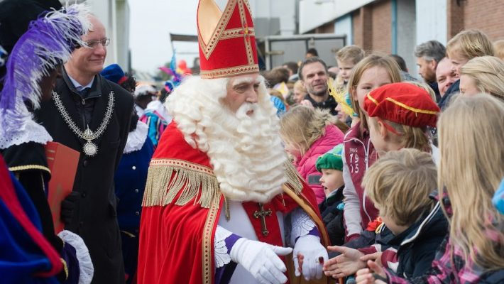 St. Nicholas greets children after arriving by boat in a Dutch harbor in this photo from 2015.