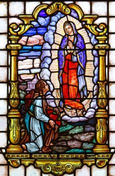 The appearance of Mary to indigenous peasant St. Juan Diego in 1531 near present-day Mexico City is depicted in a stained-glass window at St. Mary Church in Manhasset, N.Y. The feast of St. Juan Diego is celebrated Dec. 9, three days before the feast of Our Lady of Guadalupe, Dec. 12. (CNS photo/Gregory A. Shemitz) See OUR-LADY-OF-GUADALUPE Dec. 1, 2016.