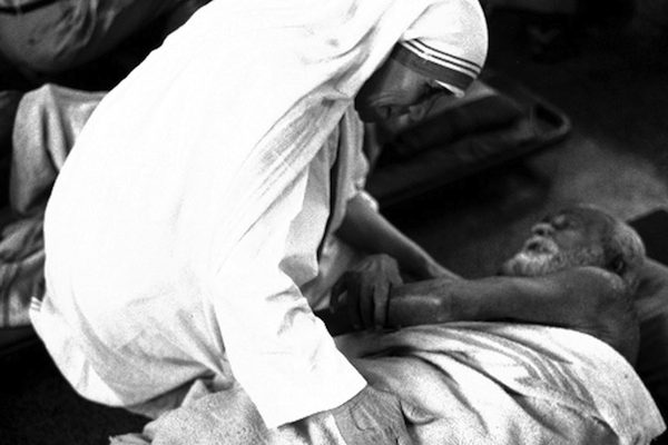 Pope Francis has approved a miracle attributed to the intercession of Blessed Teresa of Kolkata, thus paving the way for her canonization. She is pictured with an ailing man in an undated photo. (CNS photo courtesy Catholic Press Photo) See MOTHER-TERESA-SAINTHOOD-CAUSES Dec. 18, 2015.